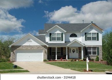 Modern middle class american home with clouds