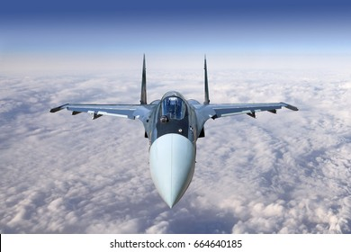 Modern military jet fighter airplane flying above the clouds.