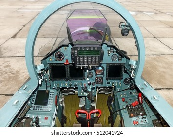 Modern military warbird airplane fighter bomber jet aircraft interior cockpit plane view with flight instruments gauges knobs buttons display units