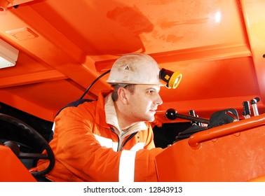 Modern miner working in a mine shaft stock photo