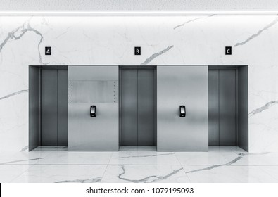 Modern minimalist business centre lobby interior with three closed steel lift doors