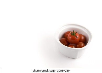 A modern minimalist white bow full of mini tomatoes, ready to be served