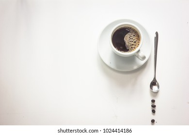 Modern minimalistic work place. White office desk table with  coffee cup. Top view with copy space, flat lay