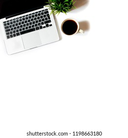 Modern minimalistic work place. White office desk table with laptop, coffee cup, top view with copy space, flat lay