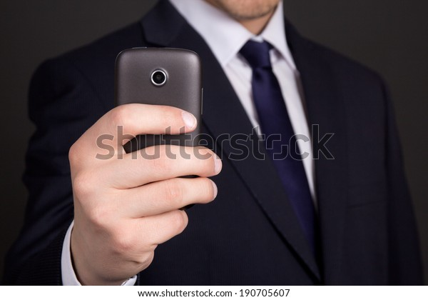 modern mobile phone with camera in business man hand