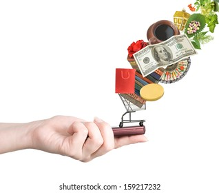 Modern mobile phone in the hand with lots of goods isolated on white (e-shopping and sale concept)
