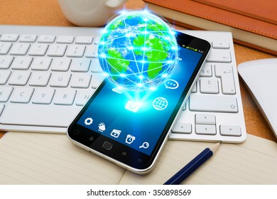 Modern mobile phone in office with cyber world flying over