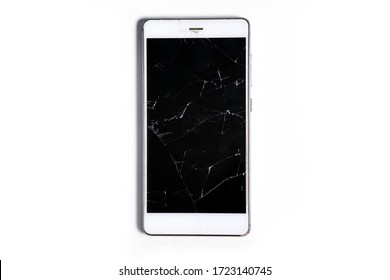 A modern mobile touch smartphone with a broken glass screen isolated on a white background. Service, repair and technological concept. Copy space for text