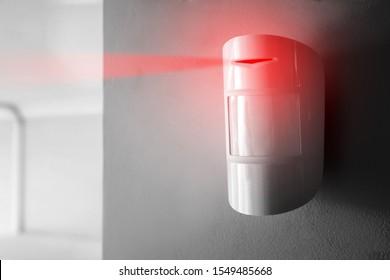 Modern motion sensor in action indoors - Shutterstock ID 1549485668