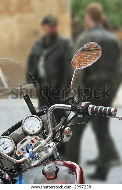 Modern motorcycle on a background of group of motorcyclists
