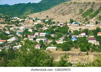 Modern mountain village. Clear summer day. Horizontal shot