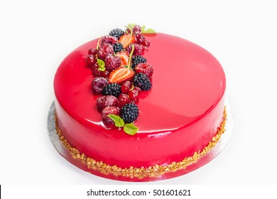 Modern mousse cake with red glaze and berries
