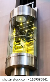 Modern moving elevator in shopping centre. Glass lift.