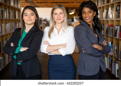 Modern multiethnic female professional team in suits stand strong on the job at work office