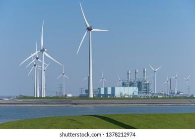 Modern multi-fuel power station and wind turbines .Eemshaven, Groningen, Holland.