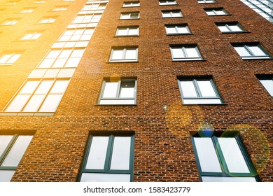 Modern multi-storey brick building with Windows. Appearance of the constructed structure. Tinted photo.