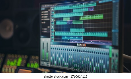 Modern Music Recording Studio Equipment: Computer Screen Showing User Interface of DAW Digital Audio Workstation Software with Track Song Playing. Sound and Music Recording and Editing Application