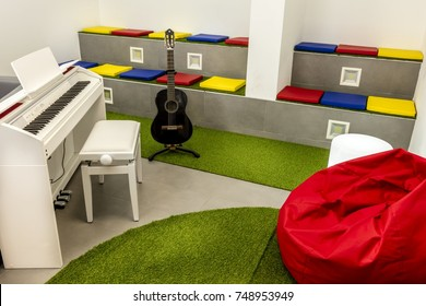 Modern Music Room, With White Piano And Black Guitar; Beanbag And Colorful  Seats