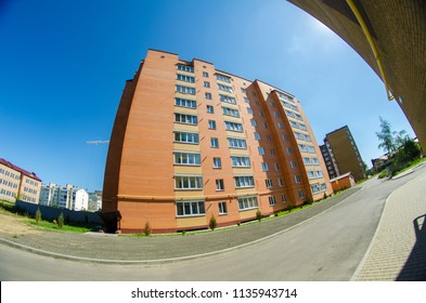 Modern and new apartment building. Multistoried, modern, new and stylish living block of flats. Real estate. New house. Newly built block of flats