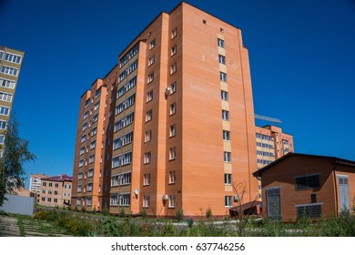 Modern and new apartment building. Multistoried, modern, new and stylish living block of flats. Real estate. New house. Newly built block of flats.