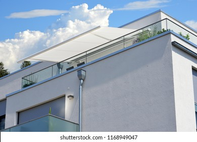 Modern new Balconies with Attic, Hand Rails of high-grade Steel electric Awning at a residential Buildings Penthouse Apartment
