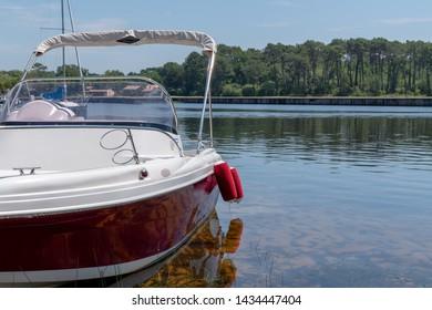modern new boat moored in lake in Lacanau France