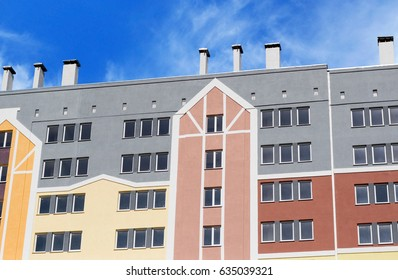 Modern, new executive apartment building on background of blue sky