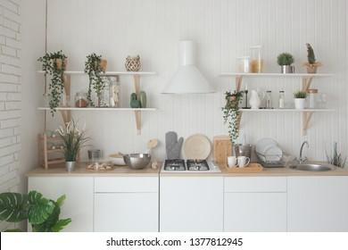 Modern new light interior of kitchen with white furniture.