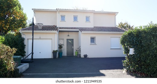 modern new recent house with garage in suburb on sunny day