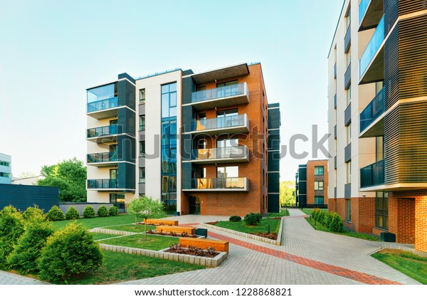 Modern new residential apartment house building complex, with outdoor facilities concept. With benches