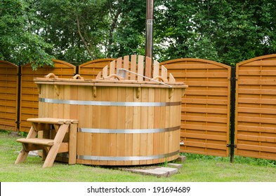modern new wooden water spa hot tub with stairs outdoor