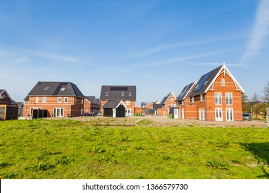 Modern newly built houses in a family friendly suburban neighborhood in Veenendaal in the Netherlands.