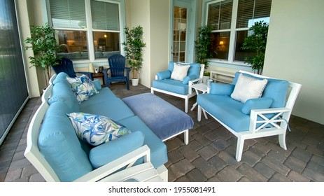 A modern nicely decorated cozy lanai  in a new home in Florida.