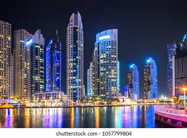 Modern night city landscape with skyscrapers. United Arab Emirates.