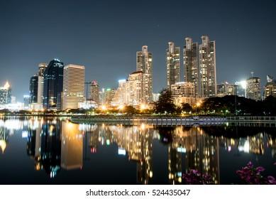 modern night cityscape in Benchakitti Park thailand