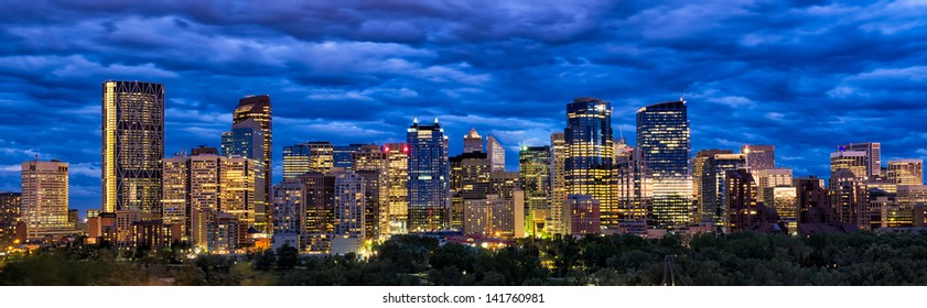 Modern night time shot of  downtown skyline full of skyscrapers - Calgary, Alberta Canada. New symbol of Calgary downtown is visible far left - Bow Building (Encana building).