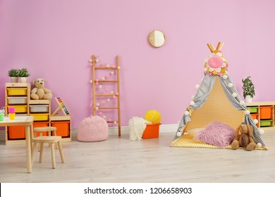 Modern nursery room interior with play tent for kids
