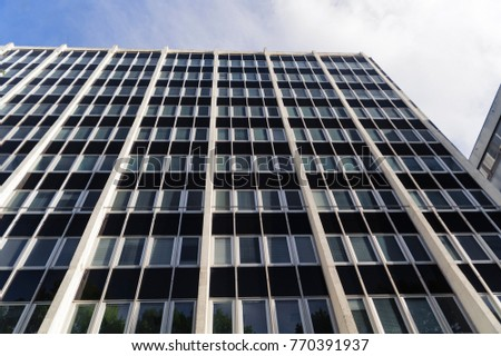 office facades. Modern Office Architecture. Close-up Of Glass Facades Office Building  With Sky Reflection ,