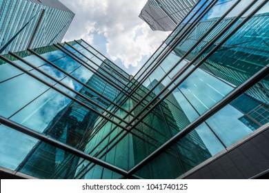 Modern office building against blue sky