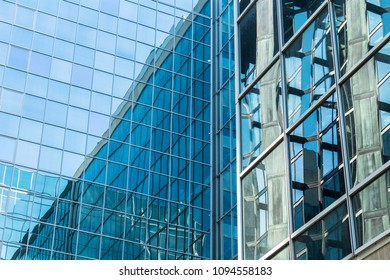 Modern office building with blue reflections