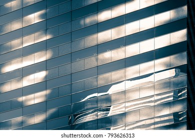 Modern office building close up in sunlight