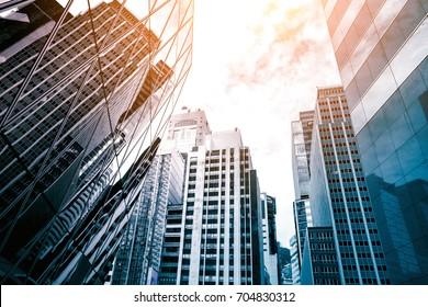 Modern office building detail, glass surface - Shutterstock ID 704830312