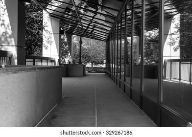 Modern office building exterior in black and white. Window reflections of glass building interior. Modern art architecture design. Urban geometry. Minimal architecture design.