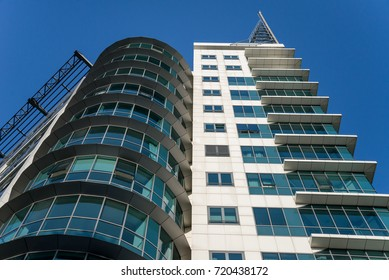 Modern office building exterior with clear blue sky