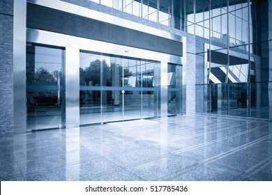 modern office building gate entrance and automatic glass door with blue tone