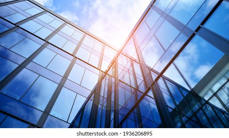 Modern office building with glass facade on a clear sky background. Transparent glass wall of office building. - Shutterstock ID 1936206895