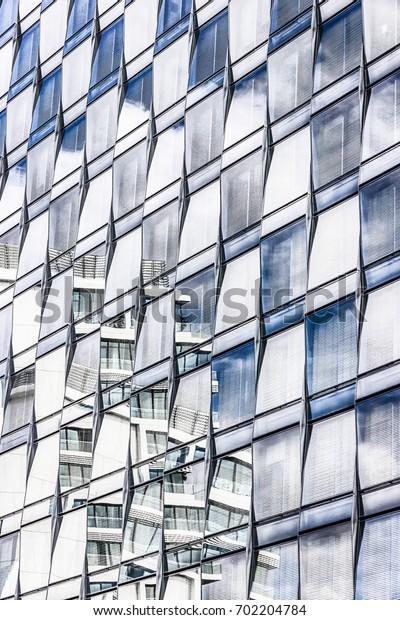 Modern office building. Mirrored windows of modern building. Details. Berlin, Germany