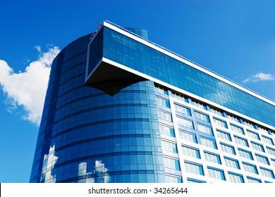 Modern office building on blue sky, daylight