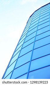Modern office building with tinted windows against blue sky