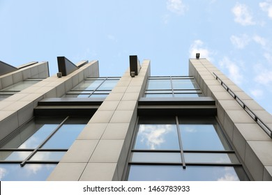 Modern office building with tinted windows on sunny day